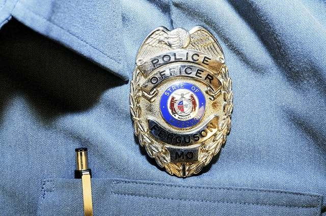 Officer Darren Wilson's police badge is pictured in this handout evidence photo from the August 9 Ferguson Police shooting of Michael Brown in Ferguson, released by the St. Louis County Prosecutor ...