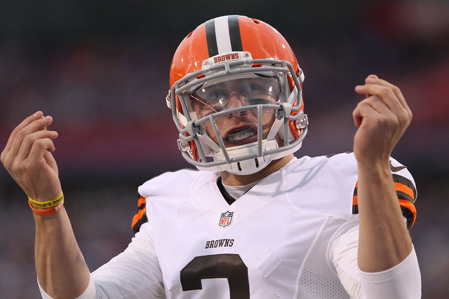 Nov 30, 2014; Orchard Park, NY, USA; Cleveland Browns quarterback Johnny Manziel (2) celebrates after scoring a touchdown in the second half against the Buffalo Bills at Ralph Wilson Stadium. The  ...