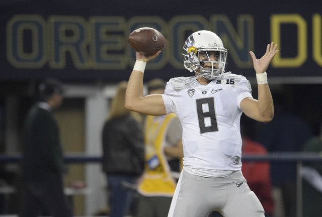 Jan 12, 2015; Arlington, TX, USA; Oregon Ducks quarterback Marcus Mariota (8) warms up prior to the game against the Ohio State Buckeyes in the 2015 CFP National Championship at AT and T Stadium.  ...