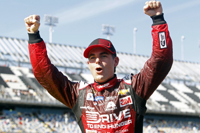 Feb 15, 2015; Daytona Beach, FL, USA; NASCAR Sprint Cup Series driver Jeff Gordon (24) celebrates winning the pole during qualifying for the Daytona 500 at Daytona International Speedway. Mandator ...