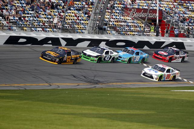 Feb 21, 2015; Daytona Beach, FL, USA; NASCAR Xfinity Series driver Brendan Gaughan (62) leads a pack during qualifying for the Alert Florida 300 at Daytona International Speedway. Mandatory Credit ...