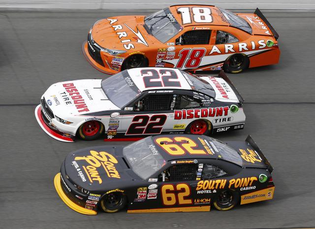 Feb 21, 2015; Daytona Beach, FL, USA; NASCAR Xfinity Series drivers Daniel Suarez (18), Brad Keselowski (22) and Brendan Gaughan (62) during the Alert Florida 300 at Daytona International Speedway ...