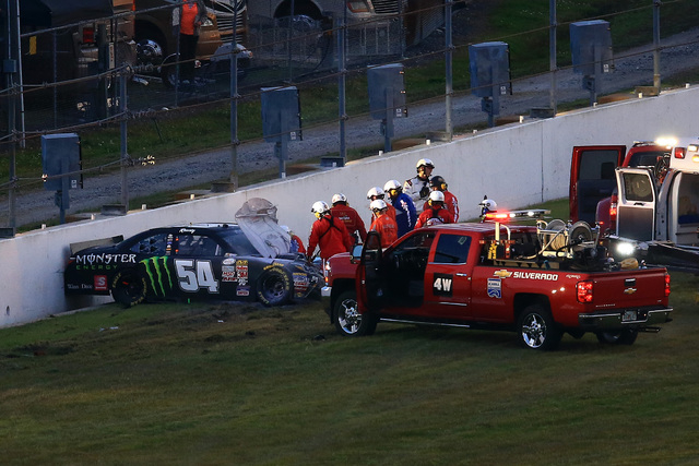 Feb 21, 2015; Daytona Beach, FL, USA; NASCAR Xfinity Series driver Kyle Busch (54) is attended to by medical staff after a wreck during the Alert Florida 300 at Daytona International Speedway. (An ...