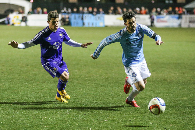 Feb 21, 2015; Charleston, SC, USA; New York City FC David Villa F (7) chases the ball as Orlando City FC Cristian Higuita M (7) chases at Blackbaud Stadium. (Jim Dedmon-USA TODAY Sports)