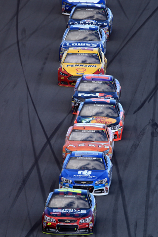 Feb 22, 2015; Daytona Beach, FL, USA; NASCAR Sprint Cup Series driver Jeff Gordon (24) leads a pack during the Daytona 500 at Daytona International Speedway. Mandatory Credit: Andrew Weber-USA TOD ...