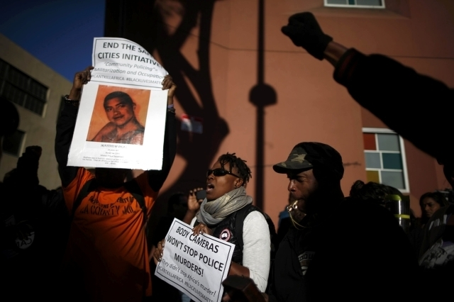 People protest against the killing of a homeless man by police in Los Angeles, March 3, 2015. Los Angeles police officers trying to subdue a robbery suspect in the city's skid row section shot and ...
