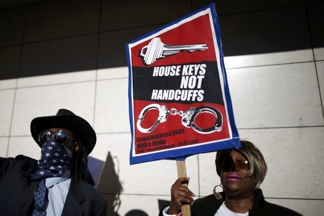 People protest against the killing of a homeless man by police outside LAPD headquarters in Los Angeles, March 3, 2015. Los Angeles police officers trying to subdue a robbery suspect in the city's ...