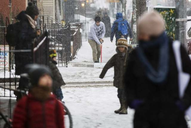 A man shovels snow off of the sidewalk during a snow storm in New York March 3, 2015. (REUTERS/Lucas Jackson )