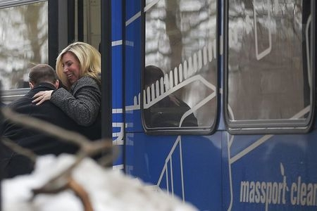 Boston Marathon bombing survivor Heather Abbott arrives on a bus at the courthouse for the beginning of the trial of bombing suspect Dzhokhar Tsarnaev at the federal courthouse in Boston, Wednesda ...
