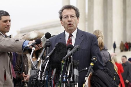 Sam Kazman, one of the attorneys against the U.S. government in the King v. Burwell case, speaks to reporters after arguments at the Supreme Court building in Washington, Wednesday, March 4, 2015. ...