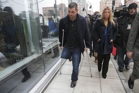 Boston Marathon bombing survivor Marc Fucarile, left, leaves the federal courthouse on the first day of the trial of accused bomber Dzhokhar Tsarnaev in Boston, Wednesday, March 4, 2015. (Reuters/ ...