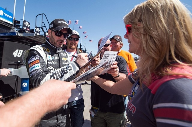 Mar 6, 2015; Las Vegas, NV, USA; Sprint Cup Series driver Jimmie Johnson (48) signs autographs during practice for the Kobalt 400 at Las Vegas Motor Speedway. Mandatory Credit: Jerome Miron-USA TO ...