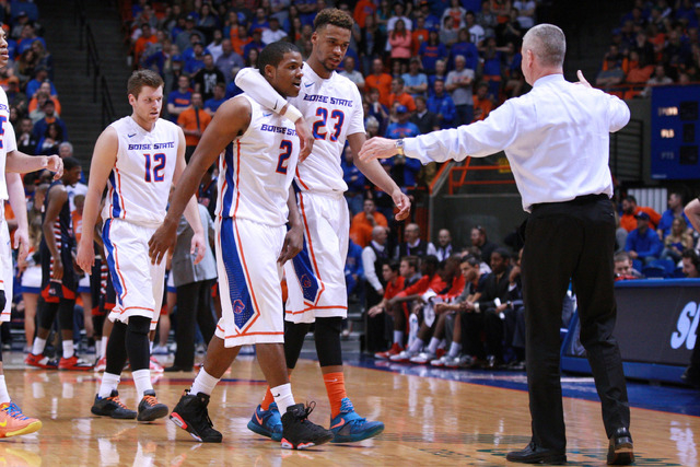 Boise State Broncos guard Derrick Marks (2) walks off the court with forward James Webb III (23) after fouling out of his final game at Boise State during the second half against  Fresno State Bul ...