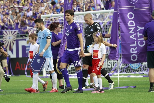 Mar 8, 2015; Orlando, FL, USA; Orlando City FC midfielder Kaka (10) and New York City FC forward David Villa (7) takes with field with youth soccer players prior to the game at Orlando Citrus Bowl ...