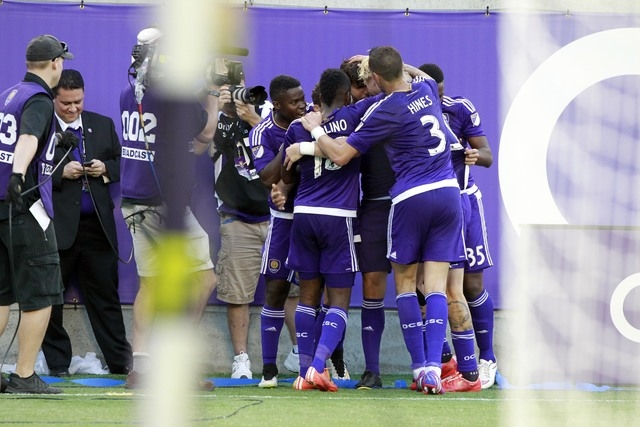 Mar 8, 2015; Orlando, FL, USA; Orlando City FC midfielder Kaka (10) is congratulated by teammates after he scored a goal against the New York City FC during the second half at Orlando Citrus Bowl  ...