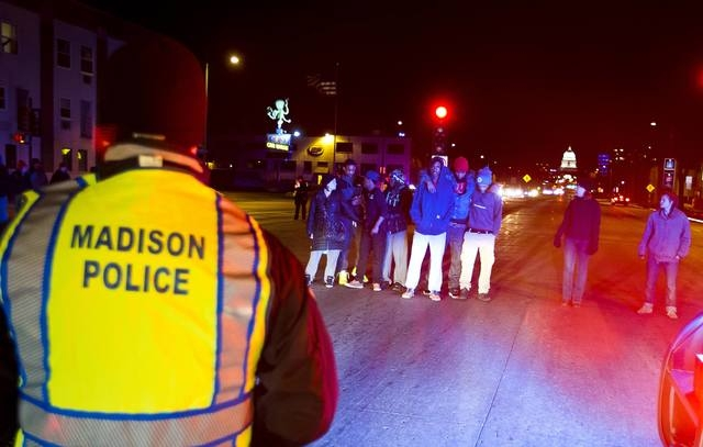 Protestors block traffic on Washington Avenue during a candlelight vigil for Tony Robinson Jr. in Madison, Wisconsin, March 8, 2015. (REUTERS/Ben Brewer)