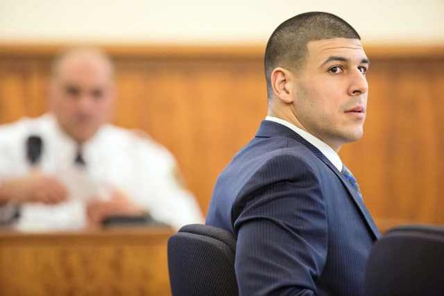 Former New England Patriots player Aaron Hernandez sits during his murder trial at the Bristol County Superior Court in Fall River, Massachusetts, March 9, 2015. (REUTERS/Aram Boghosian/Pool)
