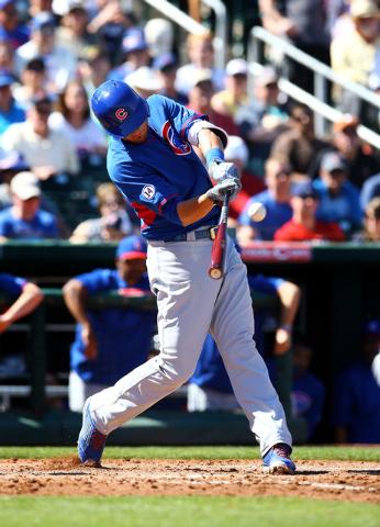 Mar 10, 2015; Goodyear, AZ, USA; Chicago Cubs third baseman Kris Bryant hits a fourth inning home run against the Cleveland Indians during a spring training baseball game at Goodyear Ballpark. Man ...