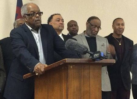 Oklahoma City Pastor John A. Reed, center, flanked by NAACP leaders and pastors of Oklahoma City African-American churches, speaks during a news conference in Oklahoma City, March 10, 2015. The Un ...