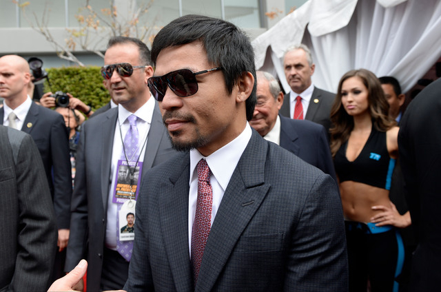 Mar 11, 2015; Los Angeles, CA, USA; Manny Pacquiao arrives for the red carpet media event before his press conference with Floyd Mayweather (not pictured) to announce their fight on May 2, 2015 at ...