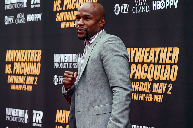 Mar 11, 2015; Los Angeles, CA, USA; Floyd Mayweather arrives on the red carpet before a press conference to announce the fight on May 2, 2015 against Manny Pacquiao at Los Angeles. Mandatory Credi ...