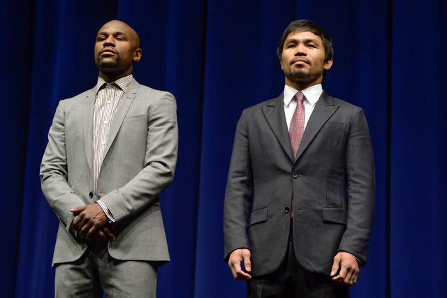 Mar 11, 2015; Los Angeles, CA, USA; Floyd Mayweather (left) and Manny Pacquiao during a press conference to announce their fight on May 2, 2015 at  the Nokia Theater in Los Angeles. Mandatory Cred ...