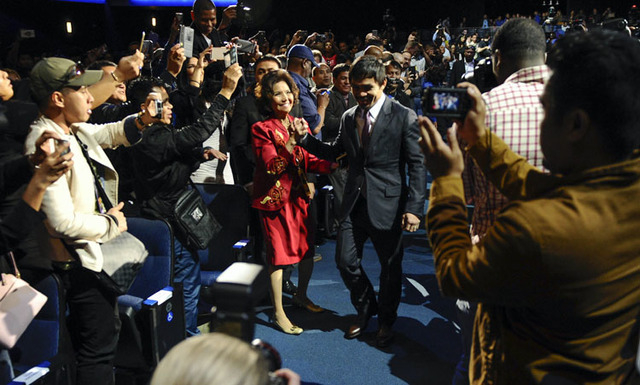 Mar 11, 2015; Los Angeles, CA, USA; Manny Pacquiaowalks through the crowd as he takes the stage for his press conference with Floyd Mayweather to announce their fight on May 2, 2015 at the Nokia T ...