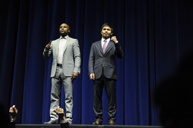 Floyd Mayweather Jr. and Manny Pacquiao pose for photographers during a press conference to announce their May 2 fight during a press conference at the Nokia Theater in Los Angeles on March 11. (R ...