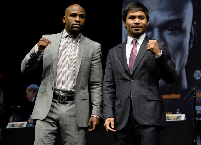 Floyd Mayweather Jr. and Manny Pacquiao pose for photographers during a press conference to announce their May 2 fight in Las Vegas during a press event at the Nokia Theater in Los Angeles on Marc ...