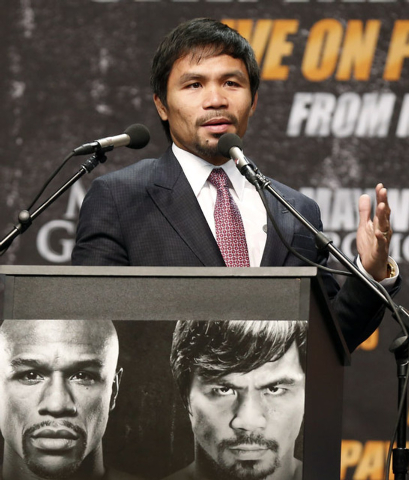 "Eight-division world champion Manny ""Pac-Man"" Pacquiao speaks at a news conference ahead of his upcoming bout with eleven-time, five-division world boxing champion Floyd ""Money&quot ..."