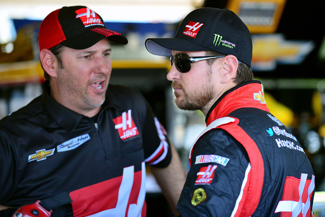 Sprint Cup Series driver Kurt Busch (41) speaks with a crew member during practice for the CampingWorld.com 500 at Phoenix International Raceway on March 13, 2015. (Gary A. Vasquez-USA TODAY Sports)