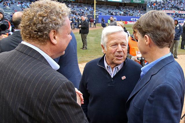 Mar 15, 2015; New York, NY, USA; New England Revolution owner Robert Kraft speaks with New York Yankees owner Hal Steinbrenner, right, and New York Yankees president Randy Levine before the New Yo ...