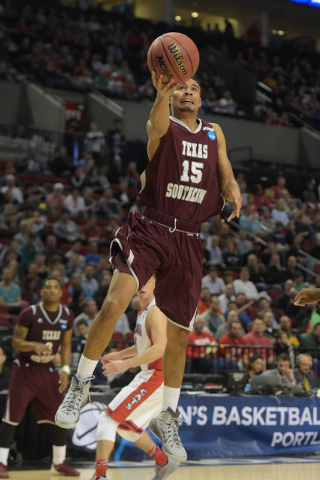Mar 19, 2015; Portland, OR, USA; Texas Southern Tigers guard David Blanks (15) shoots the basketball against the Arizona Wildcats during the second half in the second round of the 2015 NCAA Tourna ...