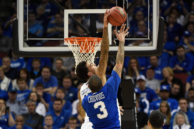 Mar 19, 2015; Louisville, KY, USA; Kentucky Wildcats forward Willie Cauley-Stein (15) blocks the shot of Hampton Pirates guard Quinton Chievous (3) during the first half in the second round of the ...