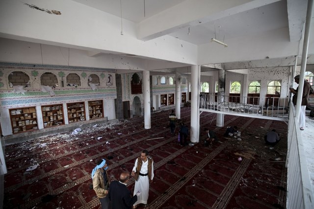 Houthi militants are seen after a suicide bomb attack at a mosque in Sanaa March 20, 2015. Suicide bombers in the Yemeni capital Sanaa blew themselves up during Friday prayers at two mosques used  ...