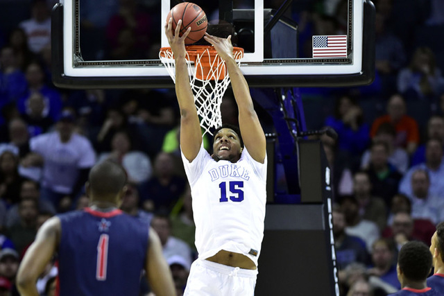 Mar 20, 2015; Charlotte, NC, USA; Duke Blue Devils center Jahlil Okafor (15) misses a reverse dunk during the second half against the Robert Morris Colonials in the second round of the 2015 NCAA T ...