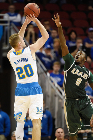 Mar 21, 2015; Louisville, KY, USA; UCLA Bruins guard Bryce Alford (20) shoots the ball against UAB Blazers guard Hakeem Baxter (0) during the first half in the third round of the 2015 NCAA Tournam ...
