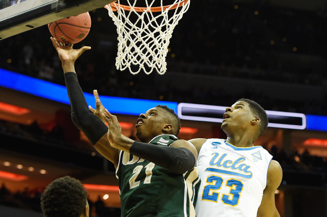 Mar 21, 2015; Louisville, KY, USA; UAB Blazers forward Tosin Mehinti (21) shoots the ball against UCLA Bruins forward Tony Parker (23) during the first half in the third round of the 2015 NCAA Tou ...