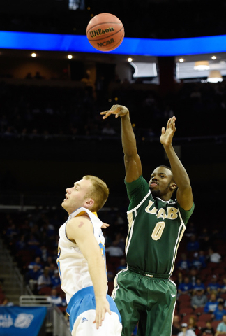 Mar 21, 2015; Louisville, KY, USA; UAB Blazers guard Hakeem Baxter (0) shoots the ball against UCLA Bruins guard Bryce Alford (20) during the first half in the third round of the 2015 NCAA Tournam ...