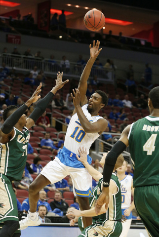 Mar 21, 2015; Louisville, KY, USA; UCLA Bruins guard Isaac Hamilton (10) shoots the ball against the UAB Blazers during the first half in the third round of the 2015 NCAA Tournament at KFC Yum! Ce ...