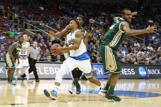 Mar 21, 2015; Louisville, KY, USA; UCLA Bruins guard Norman Powell (4) drives to the basket against the UAB Blazers during the first half in the third round of the 2015 NCAA Tournament at KFC Yum! ...