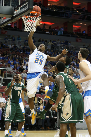 Mar 21, 2015; Louisville, KY, USA; UCLA Bruins forward Tony Parker (23) shoots the ball against the UAB Blazers during the first half in the third round of the 2015 NCAA Tournament at KFC Yum! Cen ...