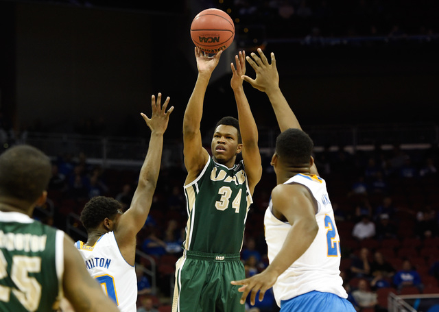 Mar 21, 2015; Louisville, KY, USA; UAB Blazers forward William Lee (34) shoots the ball against the UCLA Bruins during the first half in the third round of the 2015 NCAA Tournament at KFC Yum! Cen ...