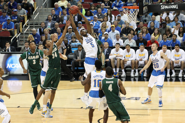 Mar 21, 2015; Louisville, KY, USA; UCLA Bruins forward Kevon Looney (5) goes up for a rebound against the UAB Blazers during the first half in the third round of the 2015 NCAA Tournament at KFC Yu ...