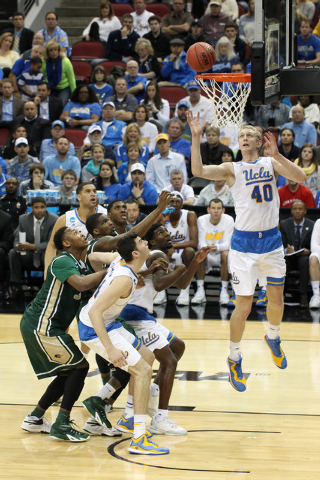 Mar 21, 2015; Louisville, KY, USA; UCLA Bruins center Thomas Welsh (40) goes up for a rebound against the UAB Blazers during the first half in the third round of the 2015 NCAA Tournament at KFC Yu ...