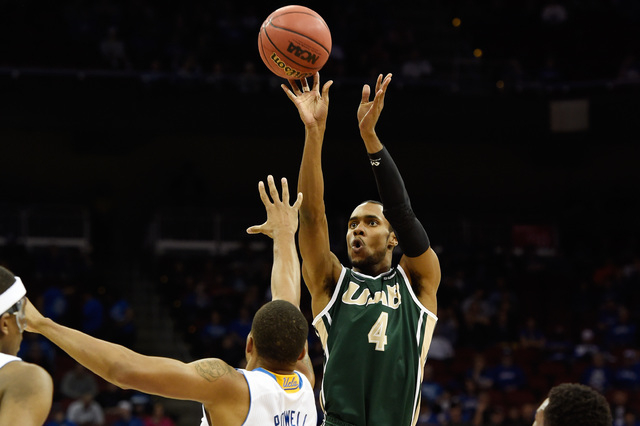 Mar 21, 2015; Louisville, KY, USA; UAB Blazers guard Robert Brown (4) shoots the ball against UCLA Bruins guard Norman Powell (4) during the first half in the third round of the 2015 NCAA Tourname ...