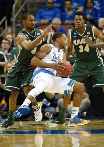 Mar 21, 2015; Louisville, KY, USA; UCLA Bruins guard Norman Powell (4) drives against the UAB Blazers during the first half in the third round of the 2015 NCAA Tournament at KFC Yum! Center. (Jami ...