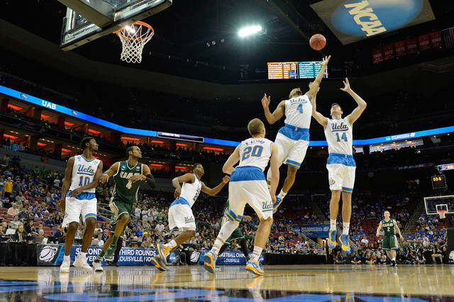 Mar 21, 2015; Louisville, KY, USA; UCLA Bruins guard Norman Powell (4) and UCLA Bruins forward Gyorgy Goloman (14) go up for the ball during the first half against the UAB Blazers in the third rou ...