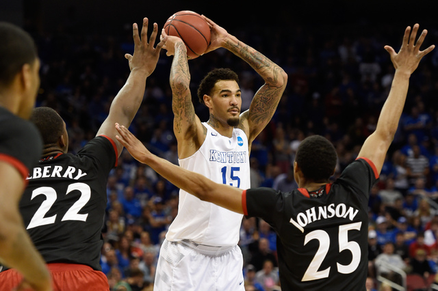 Mar 21, 2015; Louisville, KY, USA; Kentucky Wildcats forward Willie Cauley-Stein (15) looks to pass against the Cincinnati Bearcats during the first half in the third round of the 2015 NCAA Tourna ...