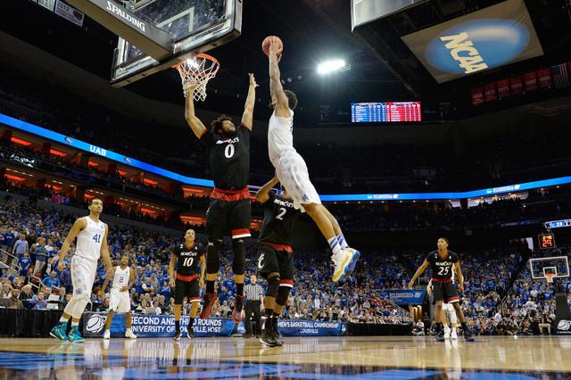 Mar 21, 2015; Louisville, KY, USA; Kentucky Wildcats forward Willie Cauley-Stein (15) dunks the ball against Cincinnati Bearcats forward Quadri Moore (0) during the first half in the third round o ...
